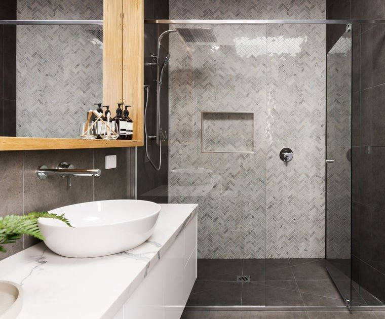 Herringbone pattern wall tiles in a contemporary shower design