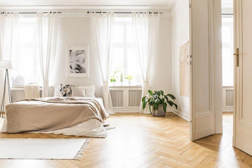 Light colour Herringbone parquet floor in bedroom