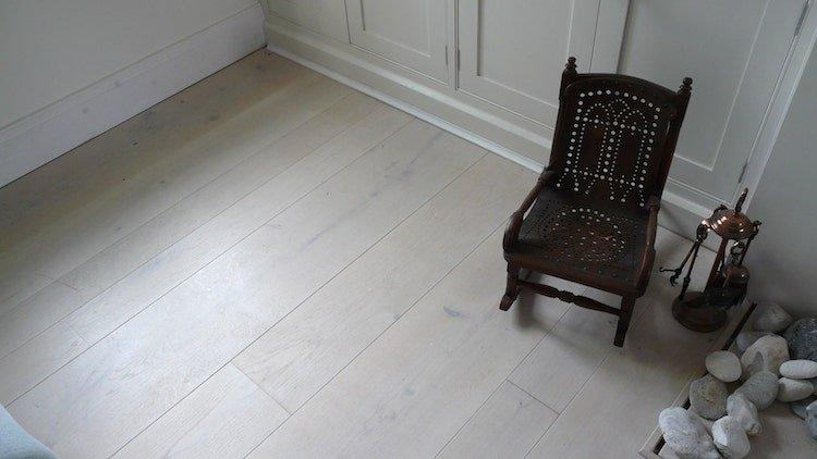 Wide plank white woooden floors by Naked Floors